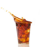 Cola glass and cola splashing Royalty Free Stock Photography