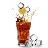 Cola glass with falling ice cubes Royalty Free Stock Images