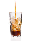 Cola glass with falling ice cubes Stock Image