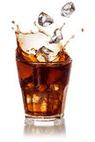 Cola glass with falling ice cubes on white. With clipping path Stock Photo