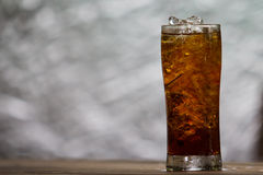 Cola. A glass of cola with ice cubes stock photo