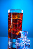 Cola glass and ice cubes Stock Images