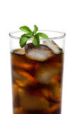 Cola in glass with stevia leave. A cold soda in a glass with ice cubes with stevia leaves Royalty Free Stock Images
