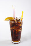 Cola in highball glass with lemon slice. On a white background Stock Image