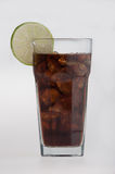 Cola in highball glass with lemon slice Stock Images