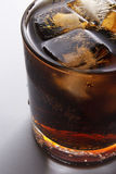 Cola with Ice. On a dark background with smooth shadow Royalty Free Stock Photography