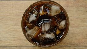 Cola on ice with bubble in glass. Cola on ice with bubble in the glass stock footage