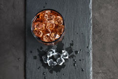 Cola with ice cube Royalty Free Stock Photos
