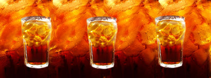 Cola with ice cubes on abstracted colas background Stock Photo
