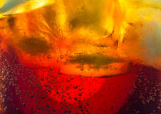Cola ice cubes bubbles macro Stock Photography