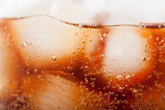 Cola with ice cubes close up. The drink cola with ice cubes close up Stock Image