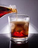 Cola with ice cubes. Cola with splash of ice cubes Royalty Free Stock Photography