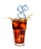 Cola with ice cubes splashing Stock Images