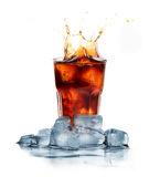 Cola with ice cubes splashing Royalty Free Stock Photo