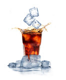 Cola with ice cubes splashing Royalty Free Stock Image