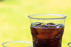 Cola with ice in cup Royalty Free Stock Photography