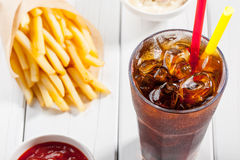 Cola with ice and french fries Stock Image