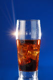 Cola and ice in glass Royalty Free Stock Image