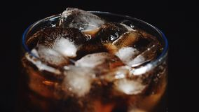 Cola and ice in glass, bubble float up stock video footage