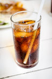 Cola with ice in a glass Stock Photography