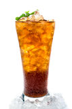 Cola with ice in a glass Stock Images