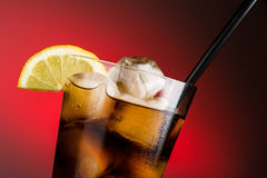 Cola and ice - horizontal close up Royalty Free Stock Image