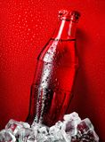 Cola on a red background Stock Photos