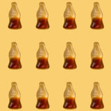 Cola jelly pattern on yellow background stock photography