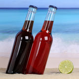 Cola and lemonade soft drinks on the beach in sand Stock Photography