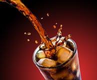 Cola med is Arkivfoto