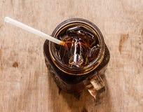 Cola no vidro com gelo de Foto de Stock