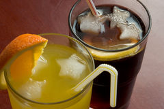 Cola and orange drinks. Possibly deep DOF stock image
