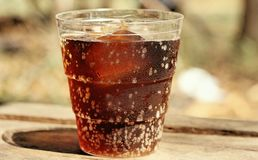 Cola på trä Arkivbild