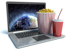 Cola, popcorn and laptop. 3d image Stock Photos