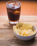 Cola and potato chips Royalty Free Stock Image