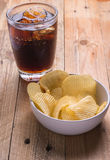 Cola and potato chips Royalty Free Stock Photos