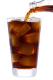 Cola is pouring into glass. On white background Stock Image