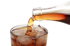 Cola pouring into a glass Stock Photography
