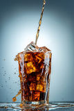 Cola pouring in a glass Royalty Free Stock Images