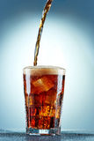 Cola pouring in a glass Royalty Free Stock Photography