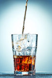 Cola pouring in a glass Stock Photos