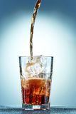 Cola pouring in a glass Stock Image