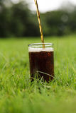 Cola pouring in a glass Royalty Free Stock Photos
