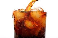 Cola pouring into glass Stock Photos