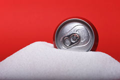 Cola refreshing drink can sitting in pure white sugar mountain Stock Image