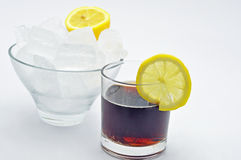 Cola with slice of lemon bowl of ice Royalty Free Stock Image