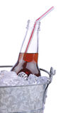 Cola Soda Botte in Bucket. Bottle of soda with straw in bucket of ice isolated on white Stock Images