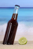 Cola soda drink on the beach Stock Photos