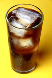 Cola soda poured in a glass with ice cubes Stock Photo