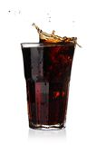 Cola splash in glass Stock Photography